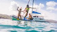 sunsail-sailing-family-jumping