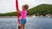 Women Standing on Trampoline of Catamaran in Corfu Greece